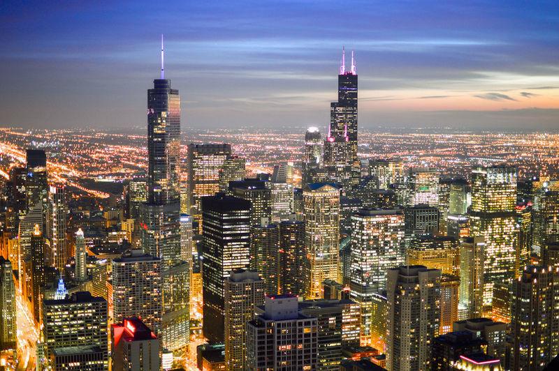 High Angle Shot Of Illuminated Cityscape Against Sky