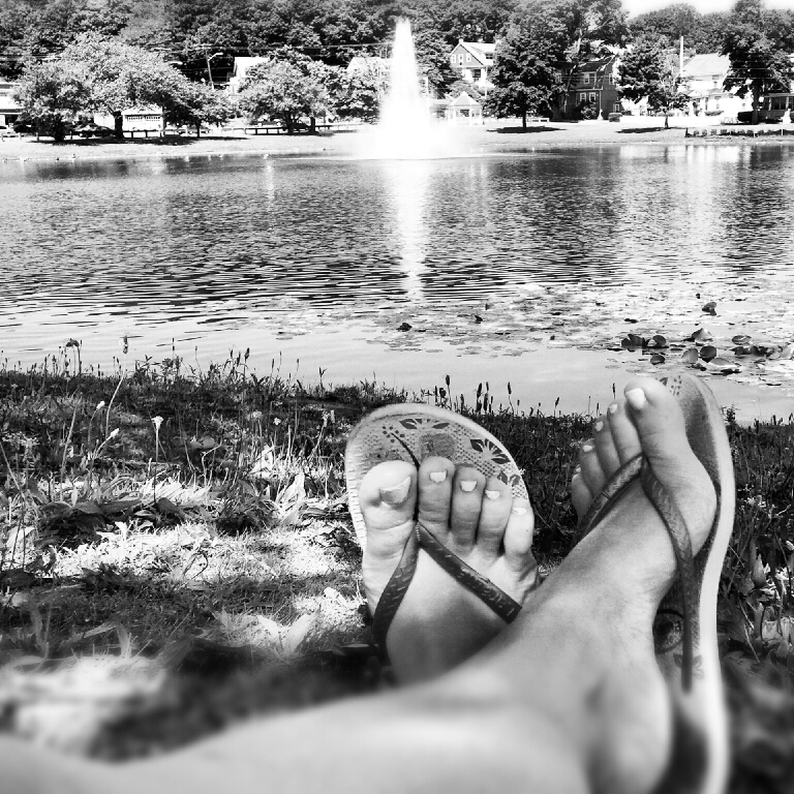 water, low section, leisure activity, person, lifestyles, relaxation, grass, lake, beach, unrecognizable person, men, nature, personal perspective, tranquility, sunlight, human foot, tree