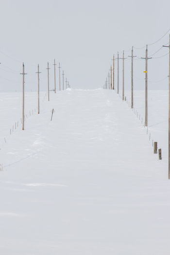Canonphotography Canon60d Snow Winter Sky Minnesota Snowdrift White Cold Hill Gravel Road Transportation Fence Power Line  Deep Closed