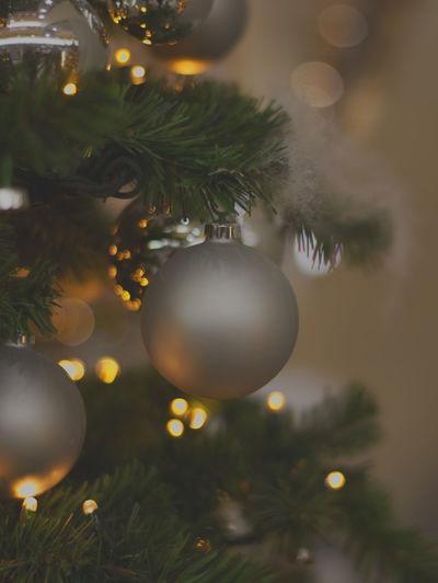 Christmas Christmas Decoration christmas tree Decoration Christmas Ornament Close-up Illuminated Christmas Lights Indoors  Celebration Event Selective Focus Silver Colored No People Tree