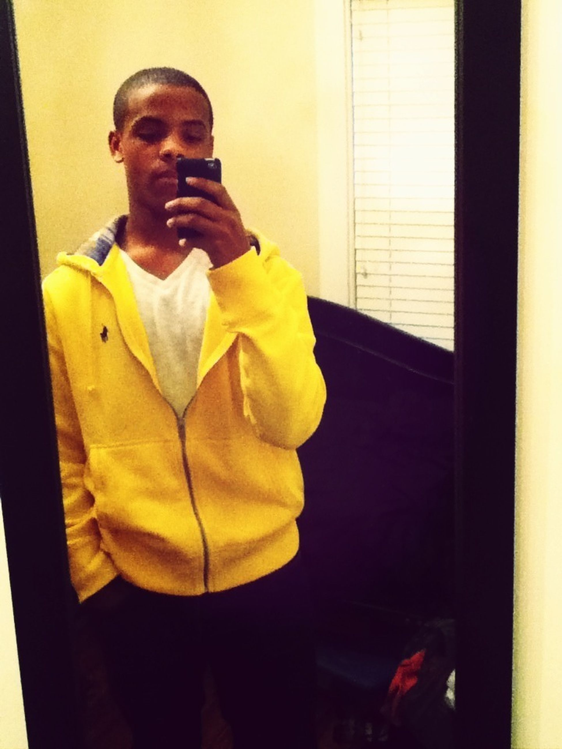 person, indoors, lifestyles, casual clothing, young adult, young men, front view, leisure activity, three quarter length, looking at camera, portrait, holding, standing, full length, smiling, sitting, yellow