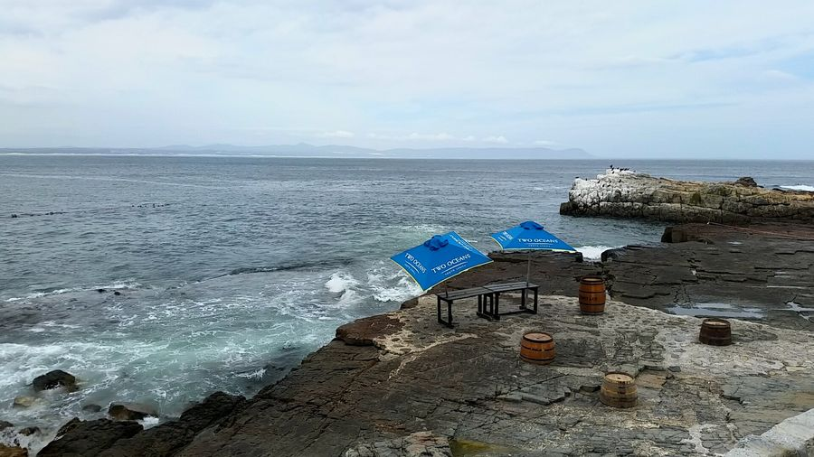 Hermanus Sea And Sky Umbrellas And Sea Seascape Photography Beauty In Nature No People Waiting For The Whales Solitude Solitude By The Water Sea View Seashore Beauty In Nature