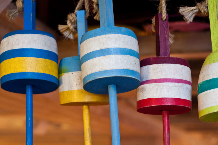 Close-up of multi colored wooden decoration hanging