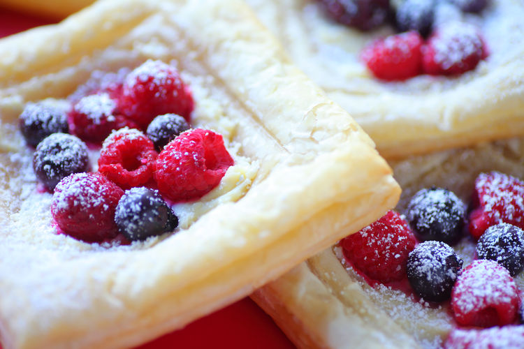 Breakfast pastries with fresh fruit Baked Blueberries Breakfast Close-up Colorful Dessert Fresh Fruit Freshness Homemade Food Indoors  Indulgence Natural Light No People Powdered Sugar Puff Pastries Raspberries Ready-to-eat Red Seasonal Food Snacks Summer Summer Berries Sweet Food Textures
