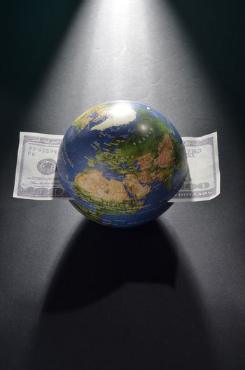 Globe filled with money Business Business Finance And Industry Financial Globe Growth Market Stocks Studio Shot