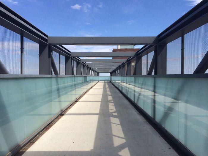 View Of Walkway Against Blue Sky