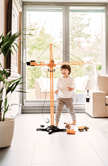 Full length of boy playing with toy at home