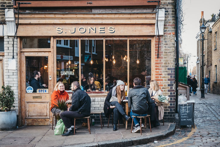 London Uk East London City City Life Weekend Activities Winter Day Cafe Real People Street Sitting Building Exterior Outdoors Restaurant People Lifestyles Millenials Urban Modern Everyday Lives People Watching Tables Group Of People Adult