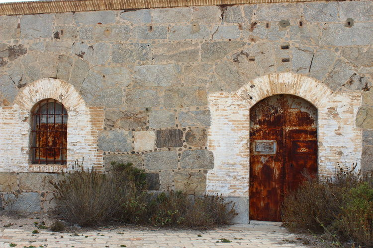 Abandoned Arch Architecture Brick Brick Wall Building Building Exterior Built Structure Day Deterioration Door Entrance History No People Old Outdoors Ruined Run-down Stone Wall The Past Wall Wall - Building Feature Weathered Window