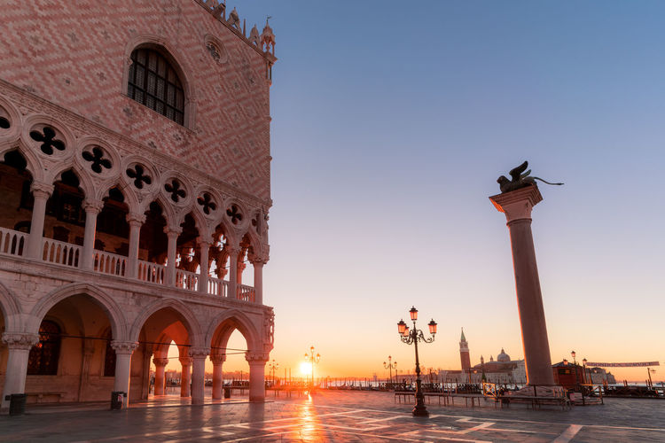 Palace at st mark square against sky during sunrise