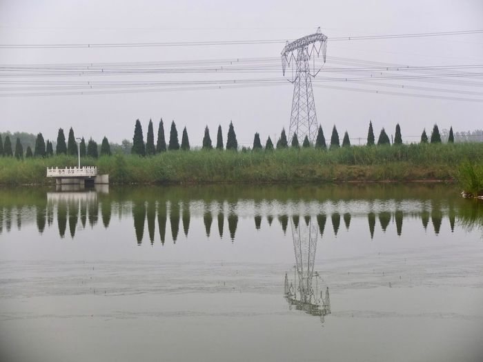 Check This Out China View China Photos Beauty In Nature Cable Connection Day Electricity  Electricity Pylon Fuel And Power Generation Hancune Village Lake Nature No People Outdoors Power Line  Power Supply Reflection Scenics Sky Technology Tranquility Tree Water