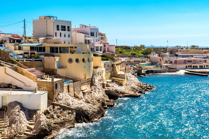 View of Marseille coast, France French Riviera Architecture Bay Of Water Beach Building Exterior Clear Sky Cliff Coast Coastline Day Europe France Marseille Mediterranean Sea Outdoors Picturesque Provence Alpes Cote D´Azur Rocky Coastline Seashore Sunny Day Tourism Urban Landscape Vacation Water