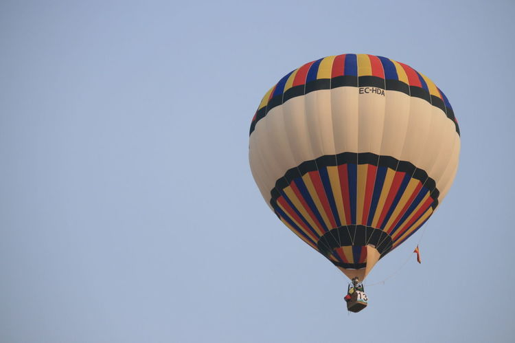Adventure Ballooning Festival Clear Sky Day Hot Air Balloon Low Angle View Multi Colored No People Outdoors Parachute Refueling Sky Vacations