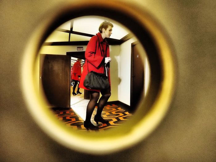 Red Coat Behind The Door Spying Spy Keyholephoto Keyhole Keyhole View Behind The Door Red Coat Full Length Standing One Person Women Real People Adult Casual Clothing Indoors  Clothing Fashion Geometric Shape