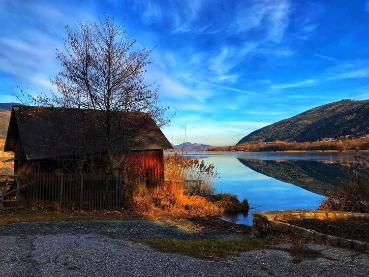Ossiachersee Ossiacher See Lake Sky Bare Tree Cloud - Sky Built Structure No People Tree Outdoors Day Water Tranquil Scene Nature Beauty In Nature Scenics Tranquility