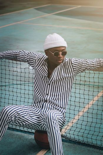 Stripes & Lines. Canon EyeEm Best Shots Photography Fashion Protrait Eyeglasses  Portrait Sitting Business Men Thoughtful Posing 17.62°