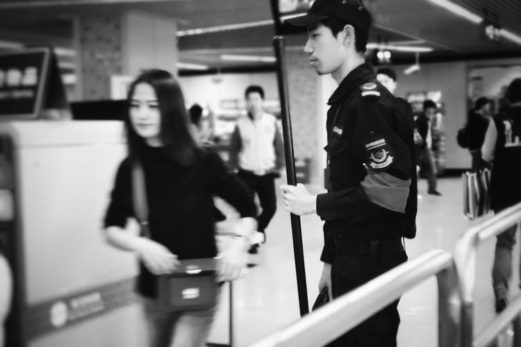 surface of Suchoow No. 4,防爆棍,The guards of Suchoow metro have equipped with the riot stick. Metro Metro Station Stick Black And White Photography Black And White Streetphotography Phone Photography Street Photography PhonePhotography Women Subway Station Riot Subway Train Blurred Motion Public Transportation Railroad Station Platform Passenger Train Railroad Track Metro Train
