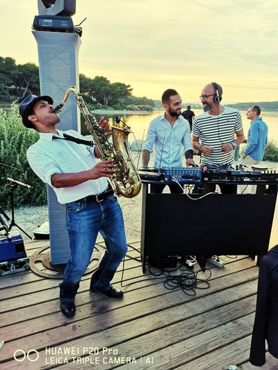 Restaurant Bar Beach Summer Saxophonist #nicovatomanga Friendship Rock Group Party - Social Event Togetherness Young Women Smiling Happiness Men Young Men