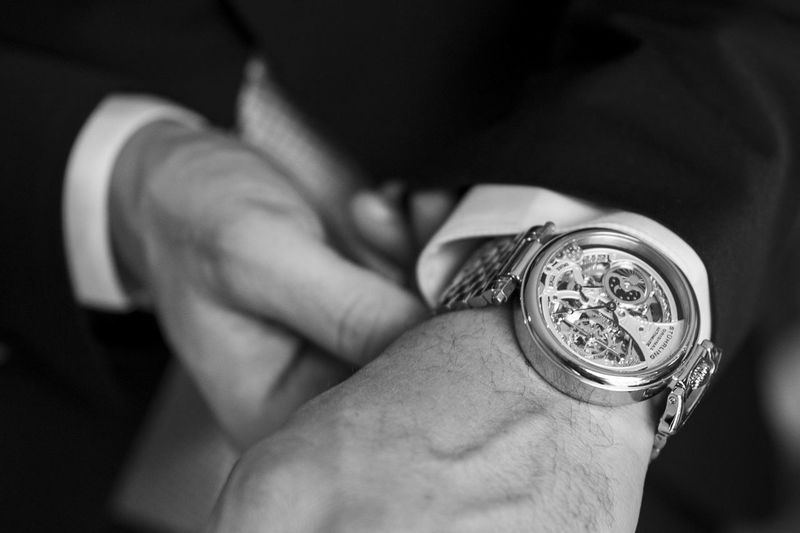 close-up on the hands of a gentleman who attaches his watch Work Nikon Light Nikonphotography Blackandwhite Lifestyles Nikonphotographer Portrait Event Human Hand Men Shirtless Time Wristwatch Coin Currency Holding Close-up