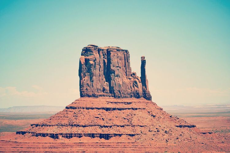 West Mitten at Monument Valley – Navajo National Parks Navajo Nation Tranquil Scene Outdoors Famous Place Navajo Reservation Navajo Country Monument Valley West Mitten Mountain Arid Climate Travel Destinations Non-urban Scene Rock - Object Arizona Utah Rock Formation Building Exterior Navajo Extreme Terrain