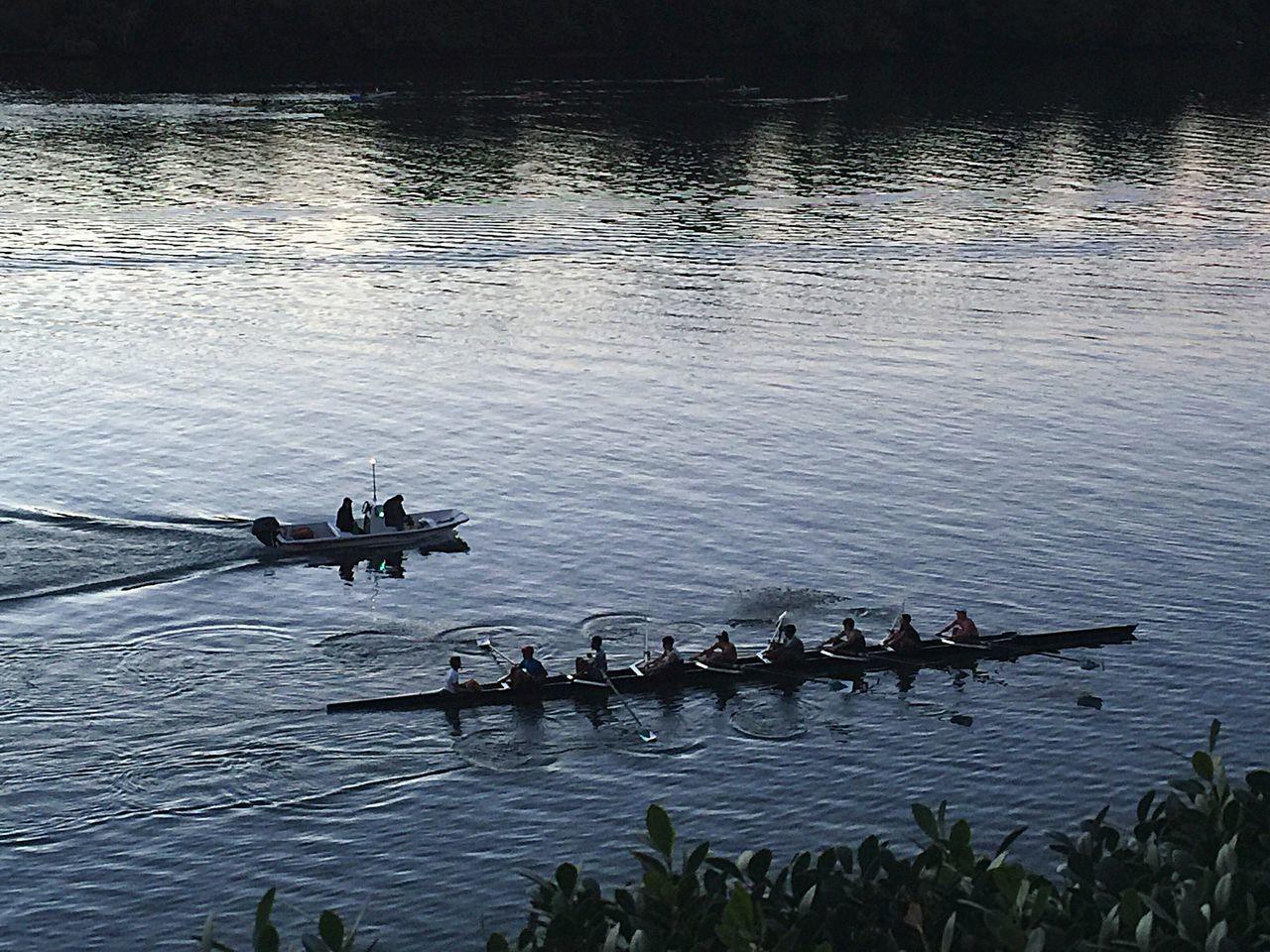 Men rowing boat in river