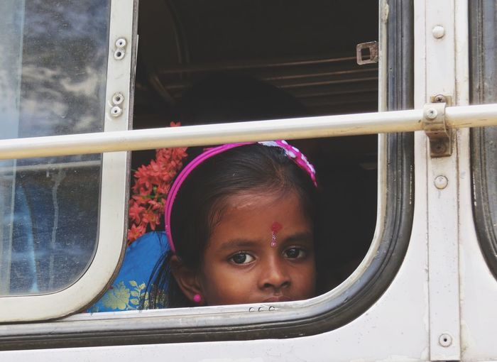 I saw this cutie on a bus, they were on the way to a wedding. Beautiful eyes! SriLanka Colombo Kid Indian Travel Photography Eye4photography  EyeEm Gallery Beautiful