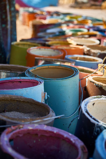 Paint cans for sale at market