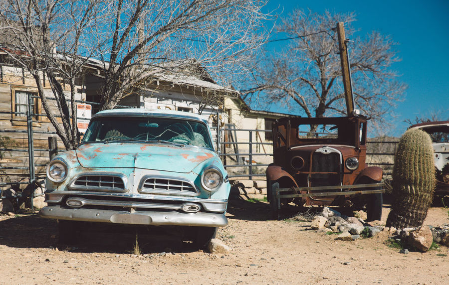 Abandoned Architecture Arid Climate Arid Landscape Arizona Bare Tree Building Exterior Built Structure Damaged Day Land Vehicle No People Obsolete Old-fashioned Outdoors Retro Styled Road Roadtrip Route 66 Route66 Run-down Tourist Attraction  Tourist Destination Transportation Tree