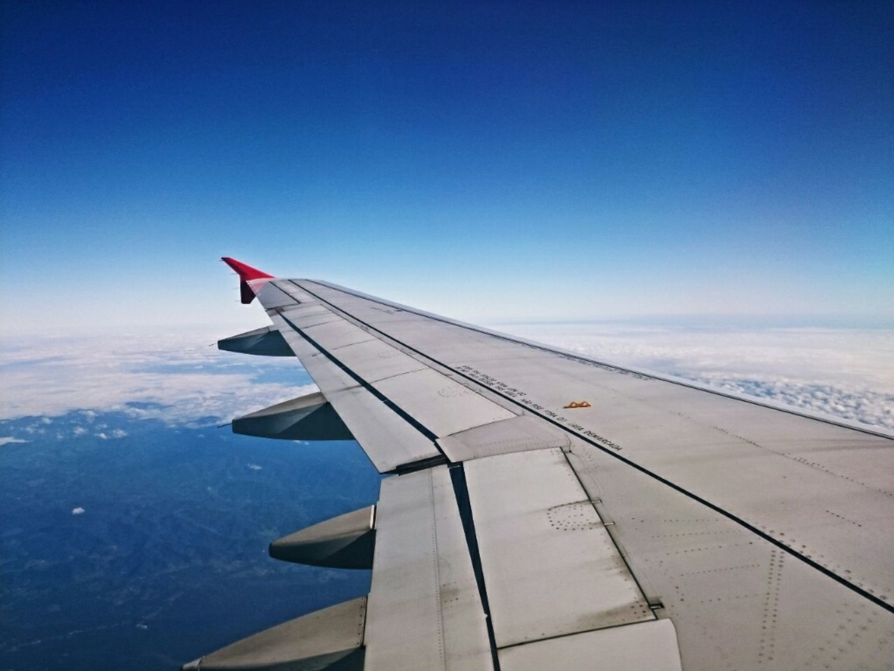 airplane, journey, transportation, airplane wing, aerial view, aircraft wing, travel, mode of transport, nature, no people, air vehicle, blue, beauty in nature, mid-air, sky, day, scenics, flying, outdoors, cloud - sky, the natural world, vehicle part, sea