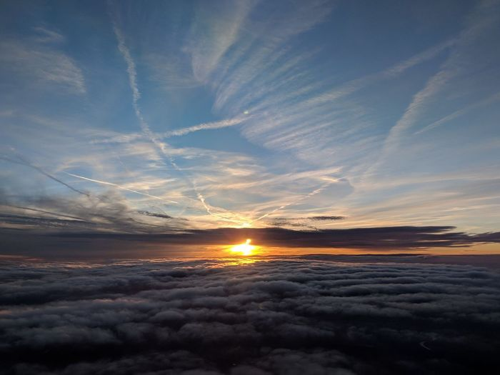 EyeEm Pretty Aerial View Sunset Flying Sunset Astronomy Blue Sunlight Sun Reflection Dramatic Sky Refraction Vapor Trail Contrail Majestic Romantic Sky Calm Air Vehicle Flight Sky Only