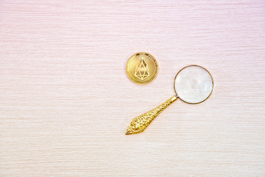 Indoors  Still Life Directly Above Wood - Material No People High Angle View Table Circle Geometric Shape Shape Close-up Gold Colored Jewelry Creativity Gold Single Object Studio Shot Wealth Pattern Design Personal Accessory