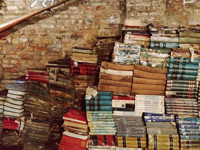 Stack of old books against wall