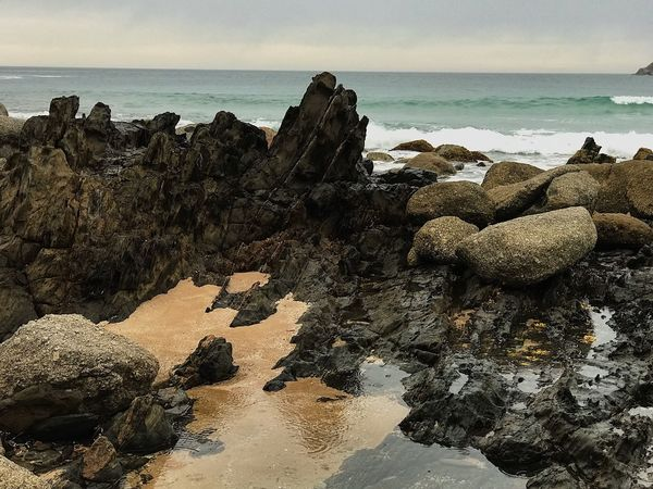 Sea Water Beach Land Sky Nature Beauty In Nature Outdoors Sunlight Rock - Object Tranquility Day Rock Scenics - Nature Horizon Over Water Tranquil Scene Horizon No People Solid Sand