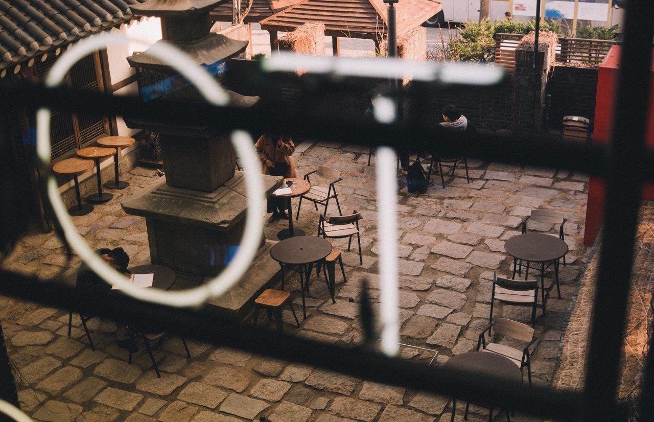 chair, selective focus, no people, architecture, day, indoors, building exterior, close-up, city
