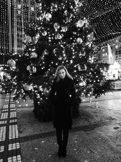 Blackandwhite Christmas Tree Christmas Decoration Christmas Lights Christmas Ornament Christmastime Christmas Around The World Christmas Time Woman Portrait Blond Beautiful Woman Full Length Model Fashion Standing Only Women One Woman Only Adult One Person Adults Only Front View