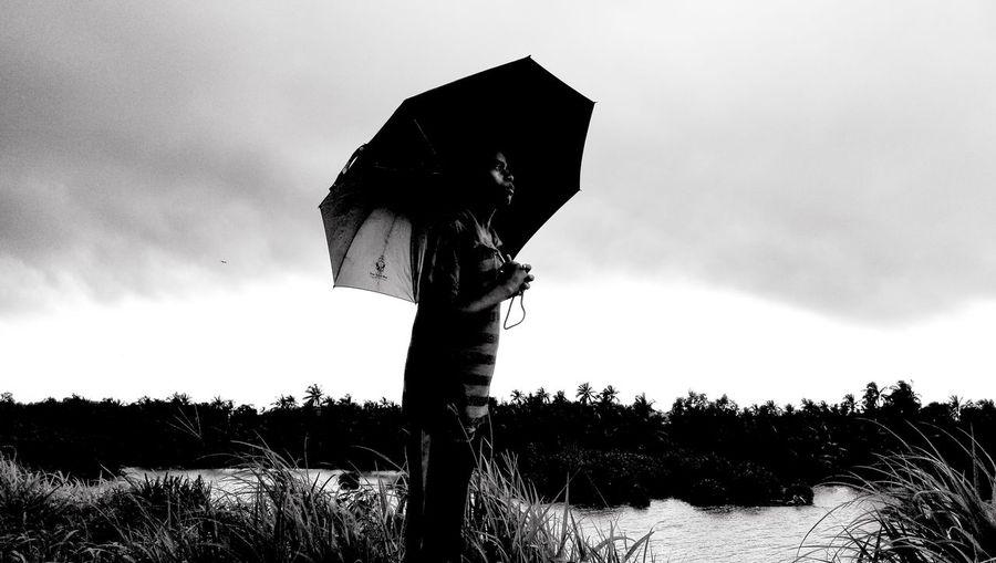 Waiting for the first drop of rain ☔ Tree Silhouette Protection Sky Cloud - Sky Thunderstorm Lightning Umbrella Rainy Season RainDrop Rainfall Power In Nature Storm Cloud Rain Storm Monsoon First Eyeem Photo