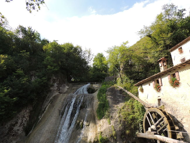 Molinetto Della Croda Beauty In Nature Day Forest Motion Nature No People Outdoors River Scenics Sky Tree Water Waterfall
