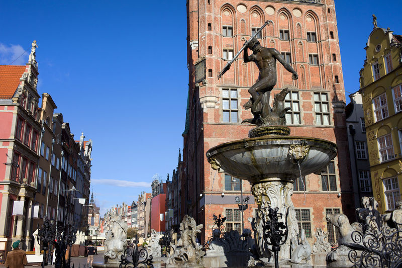 Neptune Fountain, God of the Sea bronze statue in Old Town Gdansk city, Poland City Hall Fountain God Historical Building Neptune Neptune Fountain Old Town Poland Architecture Art And Craft Bronze Statue Building Building Exterior Built Structure City Danzig Europe Gdansk Landmark Monument Mythology Roman Sculpture Town Hall Travel Destinations