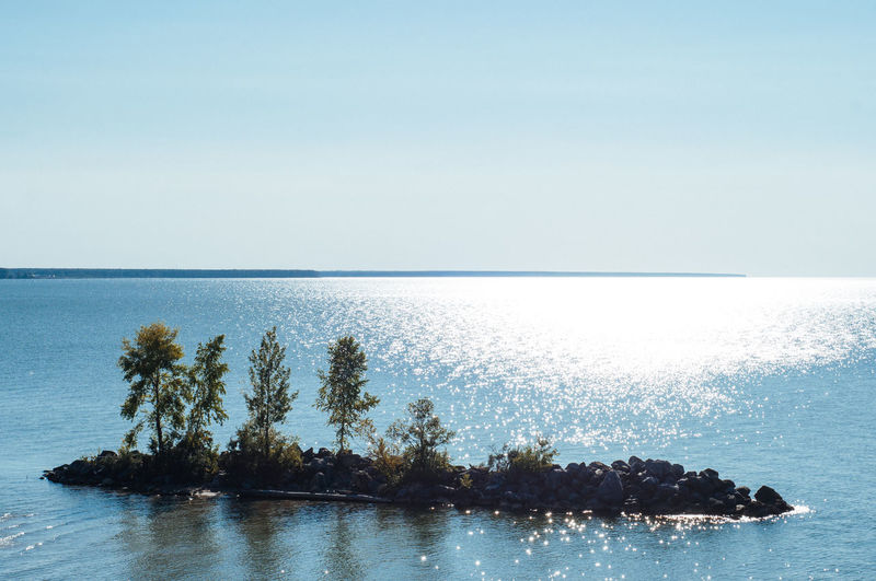 Beauty In Nature Clear Sky Copy Space Day Horizon Horizon Over Water Idyllic Land Nature No People Outdoors Plant Scenics - Nature Sea Sky Tranquil Scene Tranquility Tree Water Waterfront