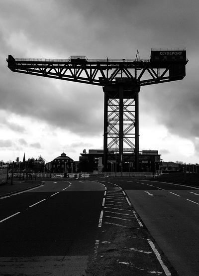 Power Crane - Construction Machinery Construction EyeEm Selects Buliding Design Sculpture Statue City Bridge - Man Made Structure Cityscape Sky Architecture Built Structure Cloud - Sky Travel Empty Road Road Marking Asphalt Dividing Line Roadways White Line