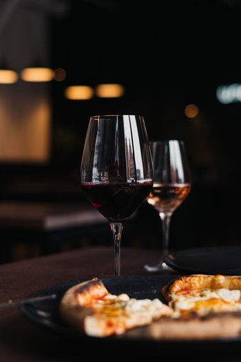 Still life shot of glasses with port wine Food And Drink Wineglass Port Wine Focus On Foreground Red Wine Glass Drink Refreshment Still Life Food And Drink Glass - Material No People Close-up Wine Pizza Pizza🍕 Restaurant Food Indoors  Alcohol Degustation