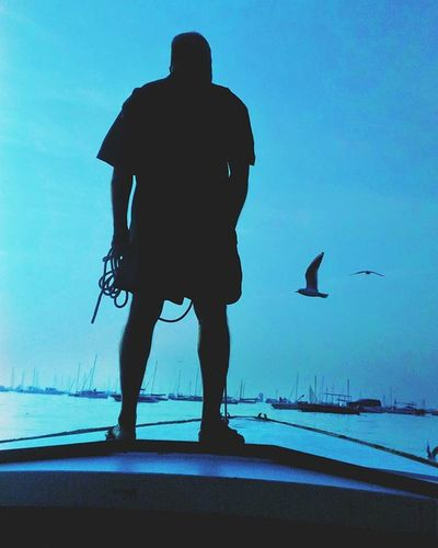 Into the Blue. Silhouette In The Ocean Blue Standing On A Boat Place Of Heart Be. Ready. Go Higher Inner Power