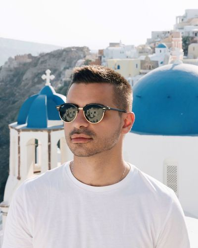 Sunglasses Day Built Structure Building Exterior Outdoors Architecture Portrait One Person Front View Looking At Camera Leisure Activity Young Men Real People Young Adult Clear Sky Eyeglasses  Close-up Sky People Santorini Santorini Island