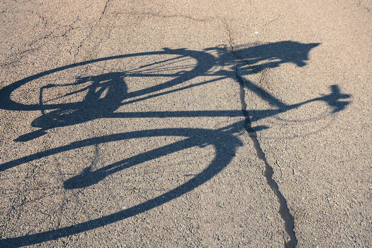 Bicycle Shadow Street Asphalt Sunlight Nature High Angle View Transportation Focus On Shadow Day No People Road Land Outdoors City Mode Of Transportation Sport Travel Sand Field Summer Wheel Transportation
