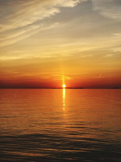 Sunset at sunset he horizon with sea infront Sunset Water Sea Sky Scenics - Nature Beauty In Nature Tranquil Scene Orange Color Horizon Reflection Horizon Over Water No People Tranquility Cloud - Sky Nautical Vessel Transportation Idyllic Waterfront Outdoors Nature