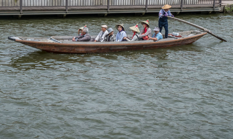 Locals and tourists sightseeing in a traditional boat ride in Itako, Japan Boat Boat Ride Boatman Canal Day Ibaraki Itako Japan Japanese  Local People Small Tourism Tourist Tourist Destination Traditional Transportation Vessel Waterway Wooden