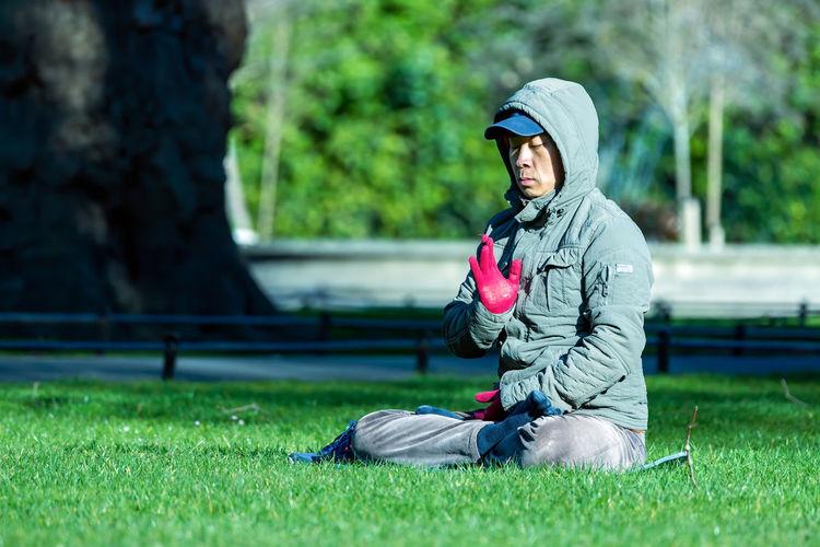 Man wearing sunglasses on field