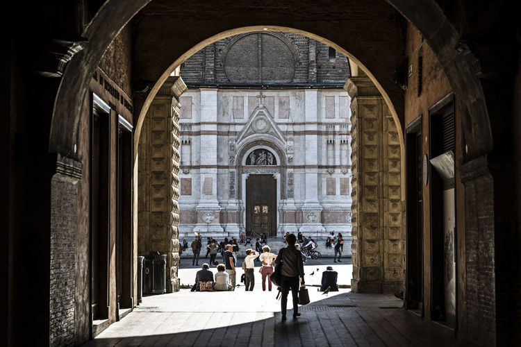 Piazza Maggiore Turists Travel Destinations The Past Ancient Design Architecture Emilia Romagna Bologna, Italy Spirituality Incidental People Architectural Column Place Of Worship Walking Building Exterior Real People Group Of People Religion History Men Women Belief Building Built Structure Arch