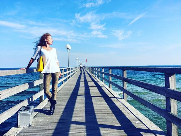 Mit Silvia in Haffkrug Full Length One Person Only Women Relaxation One Woman Only Blue Adult Summer Outdoors Happiness Women Portrait People Leisure Activity Adults Only Sea Haffkrug Ostsee Sea Sea And Sky Blue Water Landing Stage Shadows Fresh Air And Sunshine Fresh On The EyeEm