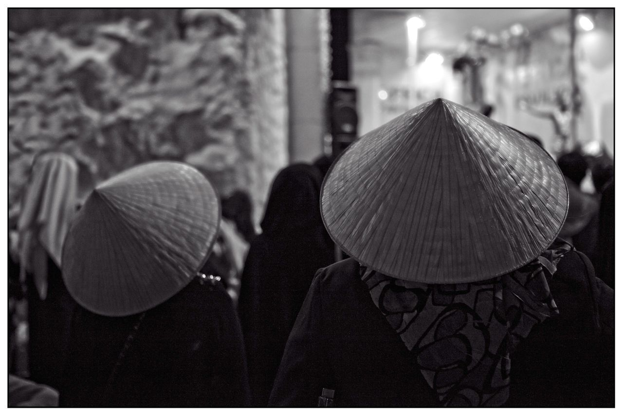 real people, hat, men, focus on foreground, asian style conical hat, traditional clothing, rear view, women, lifestyles, outdoors, headshot, day, headwear, adult, people